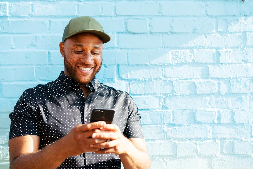 Smiling man with smart phone