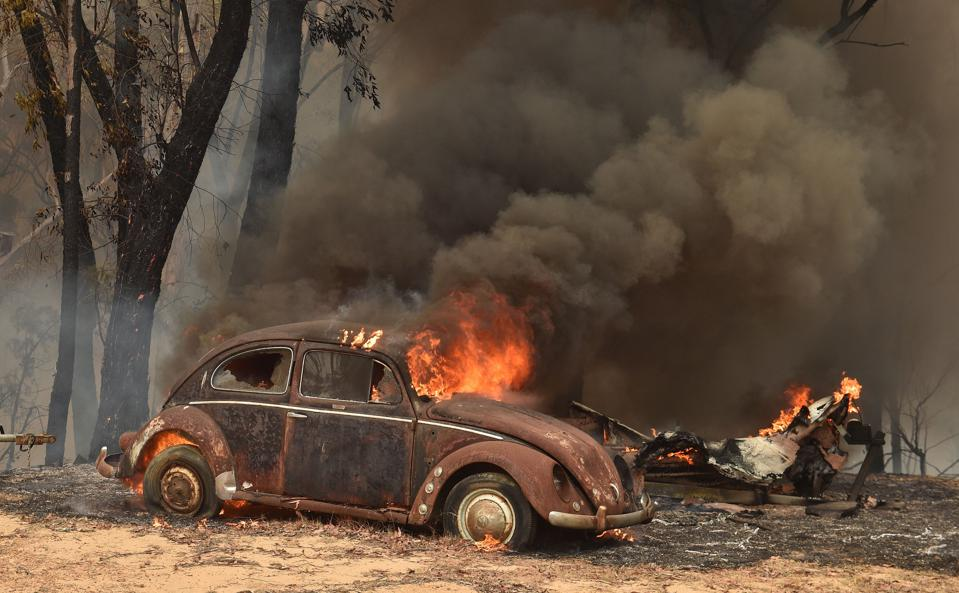 An old car burns in the wake of bushfires in Balmoral, near Sydney on December 19.