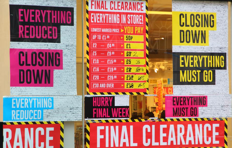 Another store has final clearance and closing sale signs up...