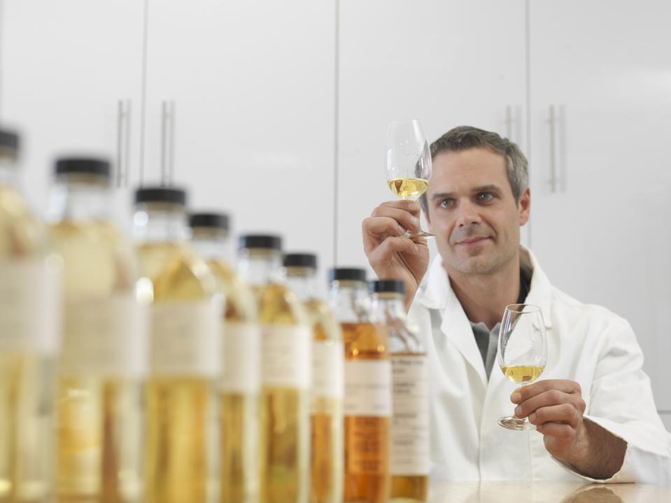 Scientist tasting whisky in plant