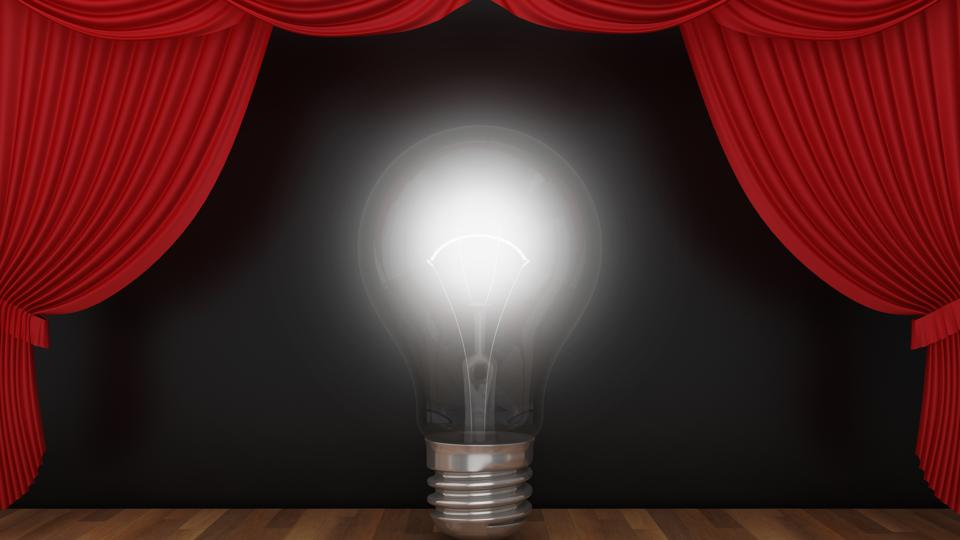 Light Bulb with Red Stage Curtains on Wood Floor - 3D Rendering