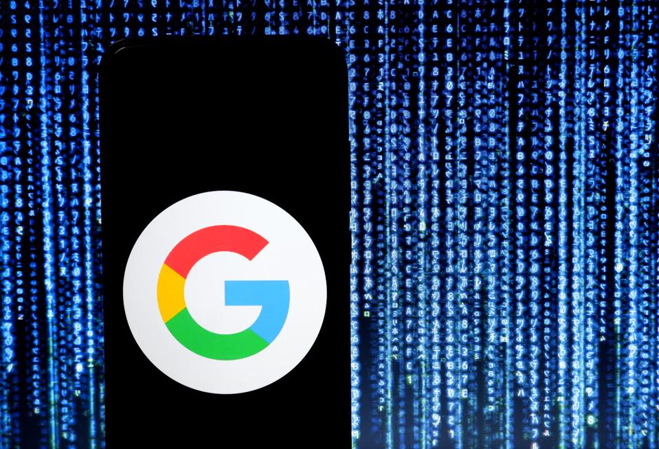 In this photo illustration Google logo seen displayed on a...