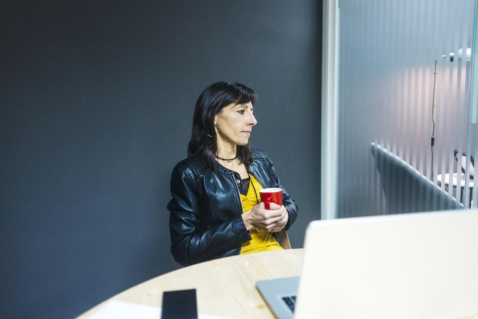 Female professional in quiet contemplation: is it time to make a career move?