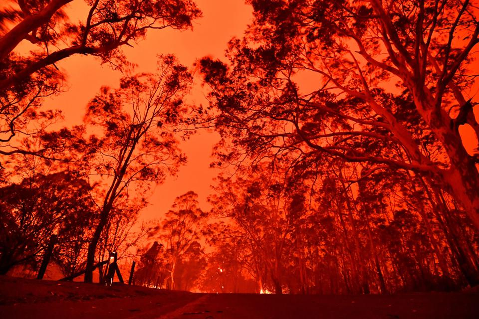 The afternoon sky glows red from bushfires December 31 near the town of Nowra in New South Wales.