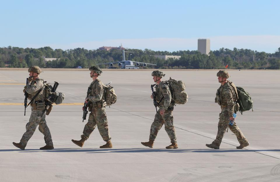 U.S. Army paratroopers deploy from Pope Army Airfield in North Carolina to the Middle East on New Year's Day.