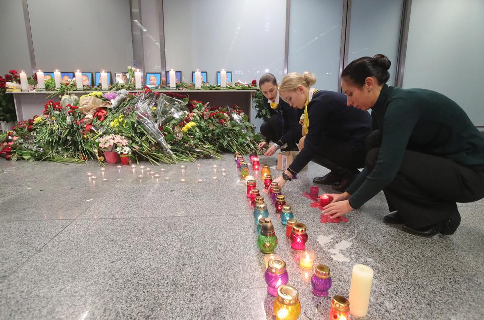 Mourners pay tribute to victims of UIA plane crash in Iran at Boryspil International Airport