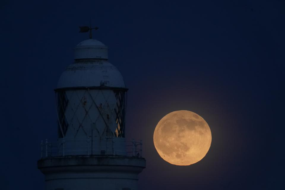 A view of the ″wolf moon″,the first full moon of 2020, over St Mary's Lighthouse at Whitley Bay in Northumberland, on the night that it coincides with a penumbral lunar eclipse. (Photo by Owen Humphreys/PA Images via Getty Images)