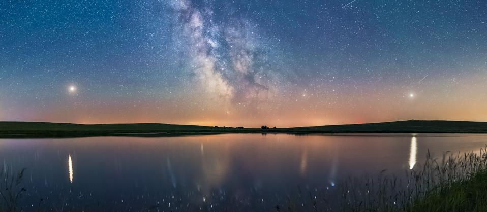 Milky Way and planets over a prairie pond in southern Alberta, Canada.