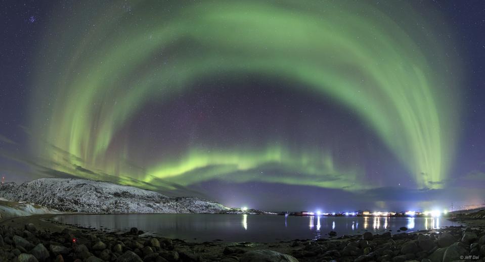 An aurora borealis dances above the Arctic Ocean from Teriberka, Murmansk, Russia.