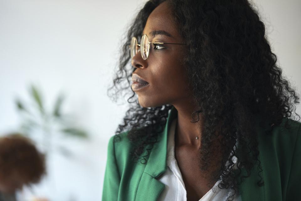 Portrait of a businesswoman in office looking sideways