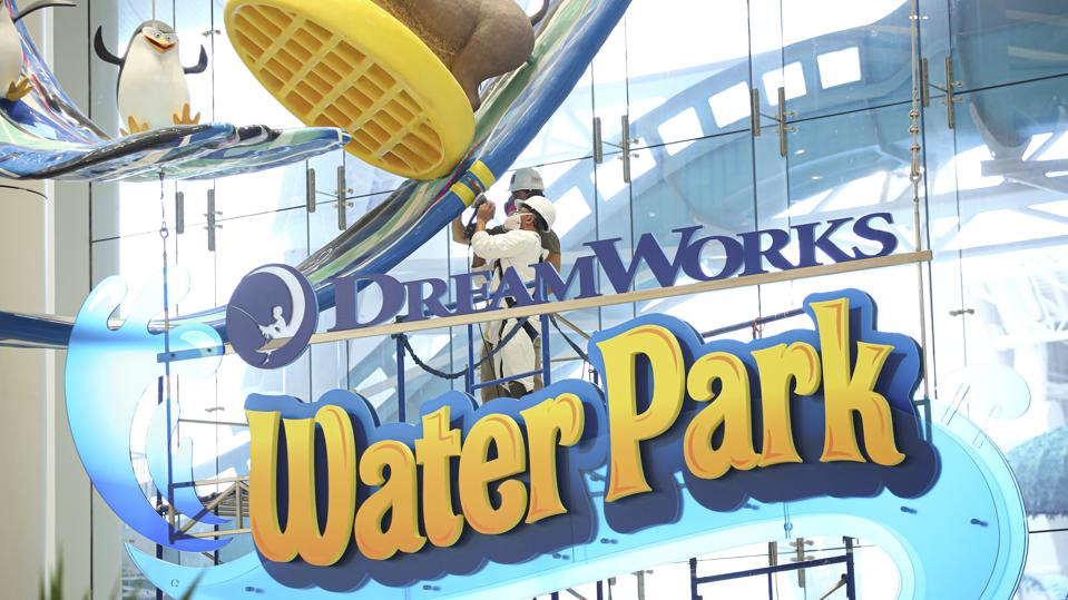 Workers can be seen cleaning a display at the Dream Works indoor water park at the American Dream mall in East Rutherford, N.J.