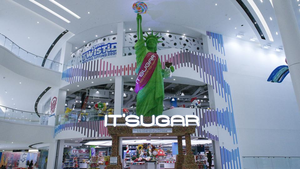 The entrance of the IT'SUGAR store at American Dream is three stories tall, with a Statue of Liberty made out of candy.
