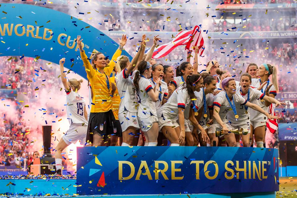 USA women's national team celebrating with trophy after the...