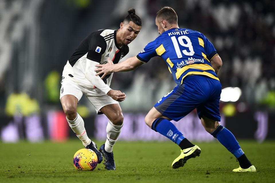Cristiano Ronaldo (L) of Juventus FC is challenged by Jasmin...