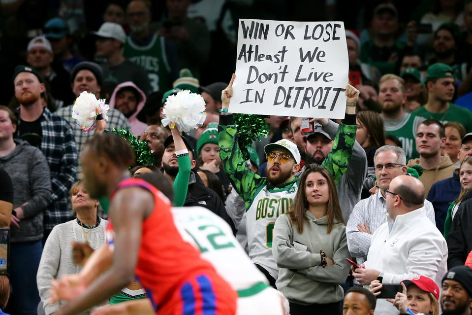 A Boston Celtics fan shows little concern for the outcome of the game, is grateful to at least not be living in Detroit.