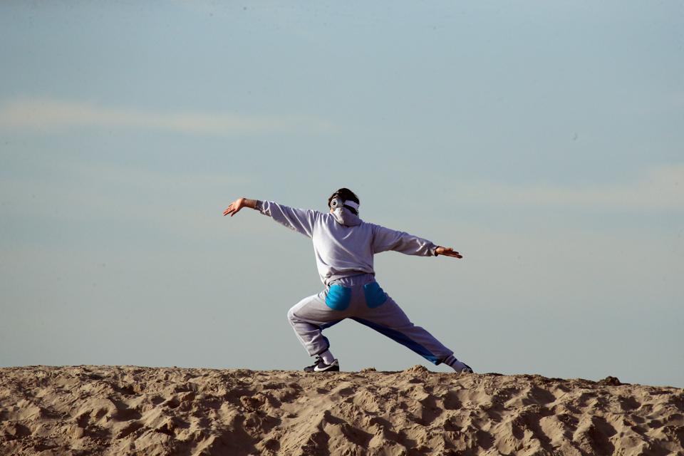 Venice Beach Scenics Man doing yoga staying calm