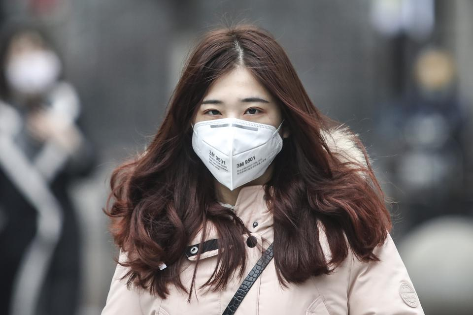 Woman With Protective Mask During Coronavirus Pneumonia Outbreaks In China