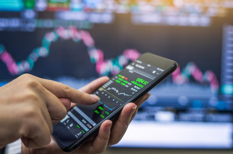 Businessman checking stock market on mobile phone,Stock market