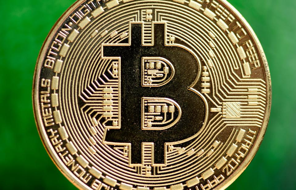 Bitcoin, a cryptocurrency, displayed against a green background.