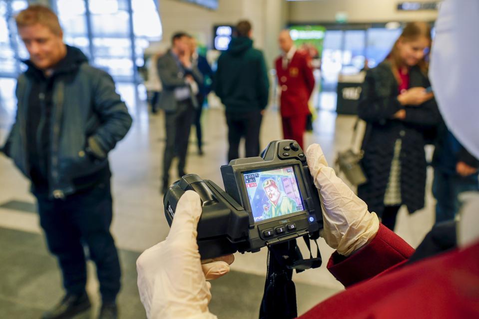 Temperature screening of arriving passengers for coronavirus prevention at Moscow's Vnukovo Airport