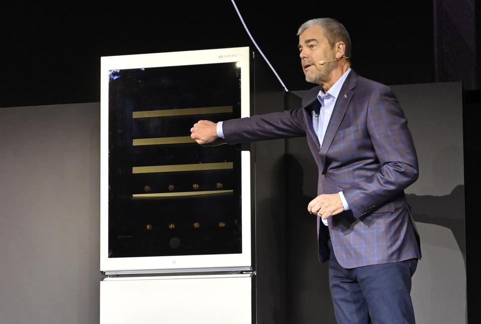 LG Electronics USA SVP of Marketing David VanderWaal demonstrates new LG tech at CES.