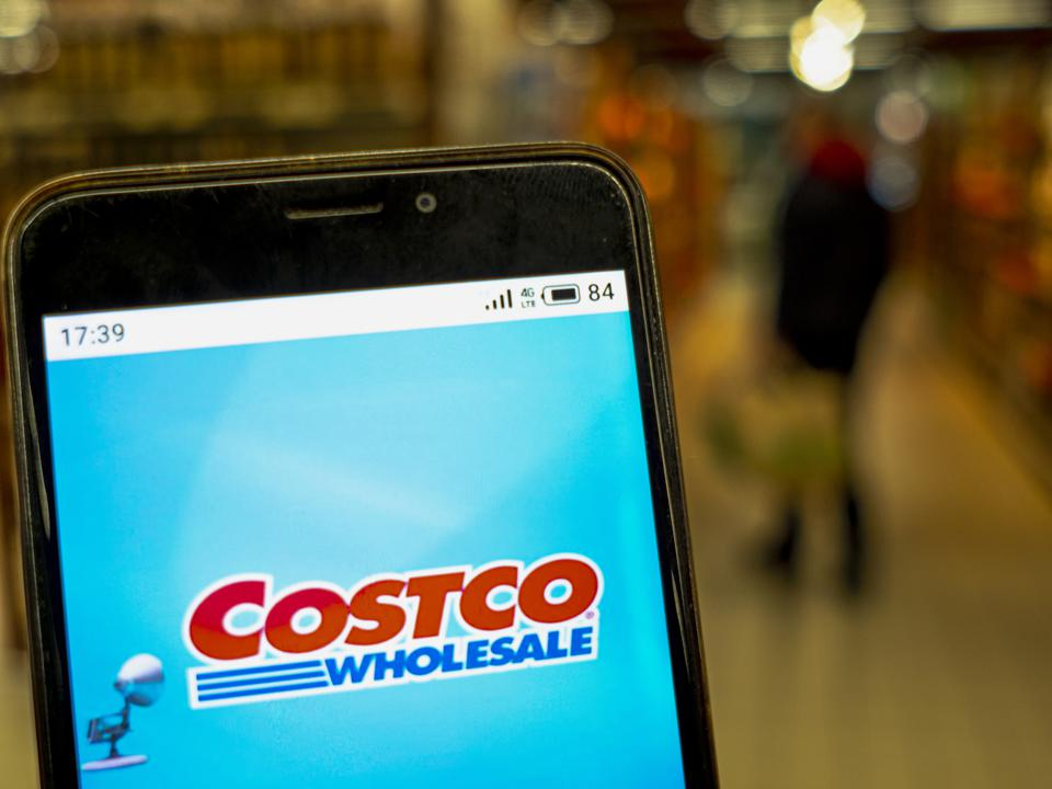 In this photo illustration the Costco Wholesale logo is seen...