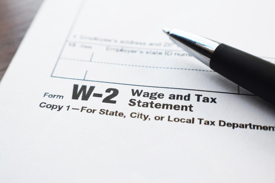 Tax Form W-2 Close Up With Pen High Quality