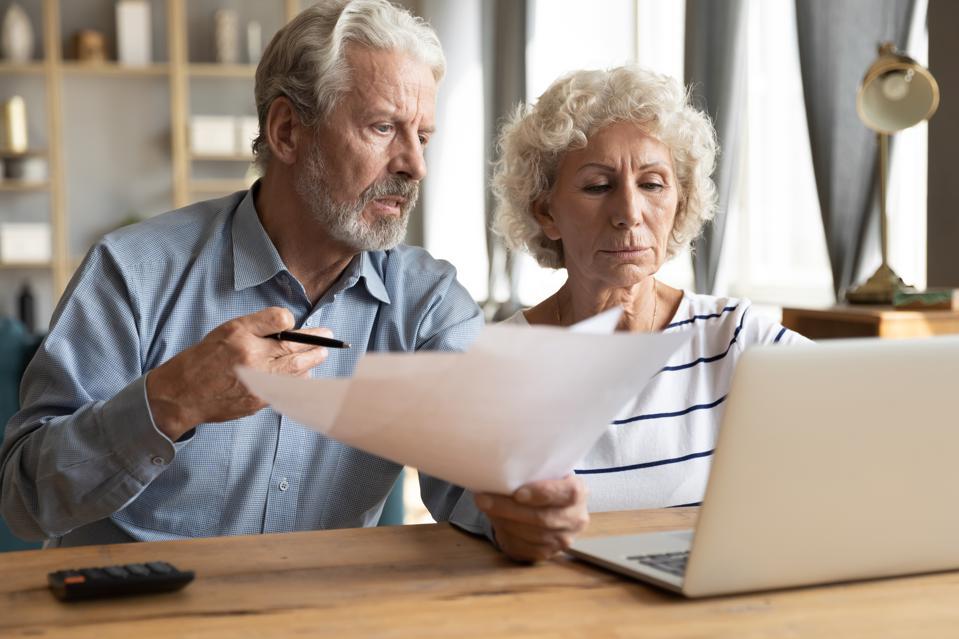 Elderly couple manage budget having unpaid debts feels stressed