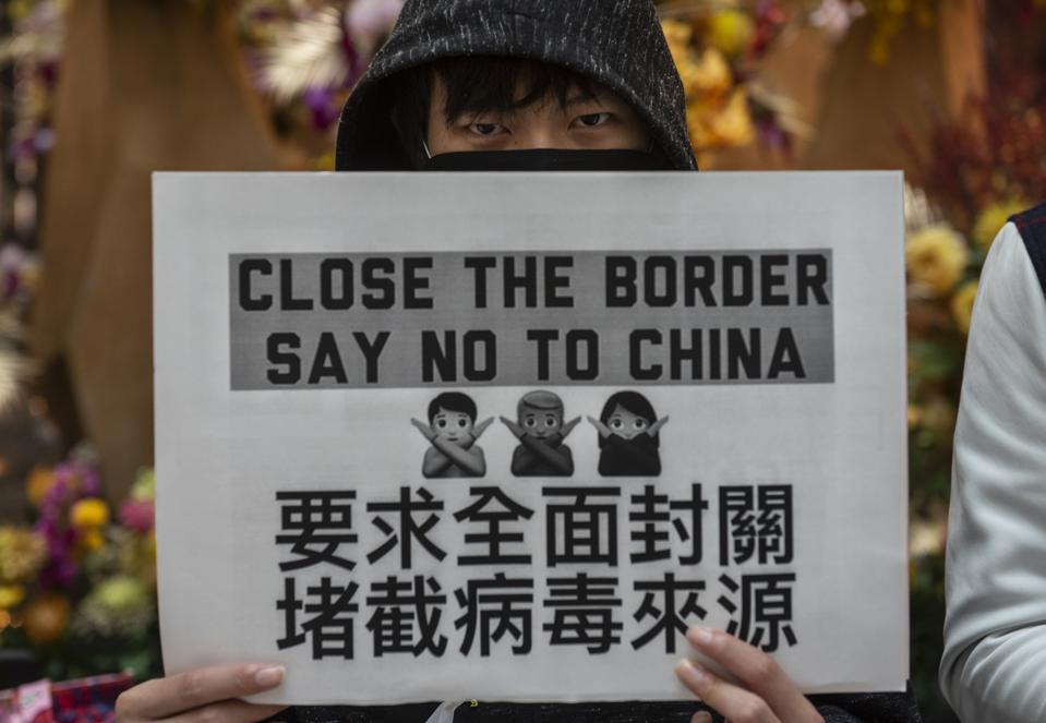 A demonstrator holds a placard during a protest calling on...
