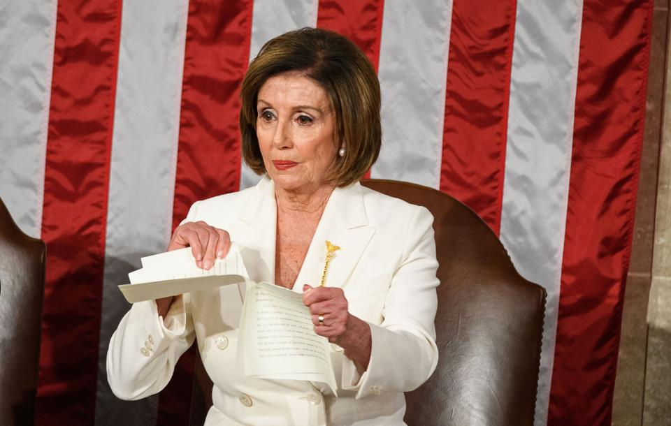 Nancy Pelosi rips Trump's speech in half.