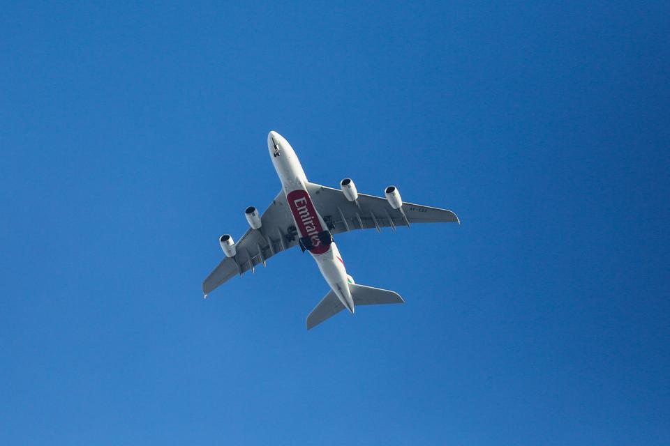 An A380 Emirates Airline with its landing gear down is seen...