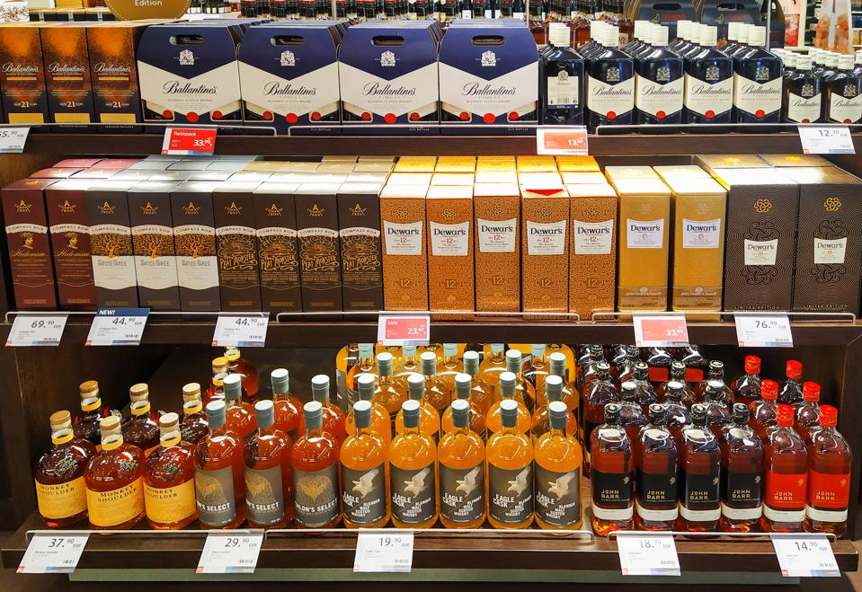 Bottles of various whiskey brands seen displayed at the Duty...