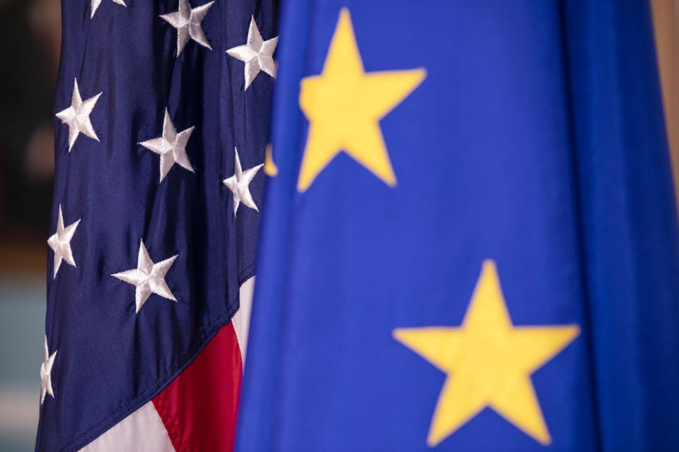 European Union and United States flags on display amid EU travel ban on US