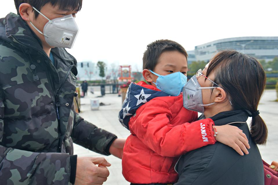 A doctor who will go to support Wuhan to fight against novel coronavirus pneumonia kisses goodbye to her 5 years old son in Shaoxing, Zhejiang,China on 10th February, 2020