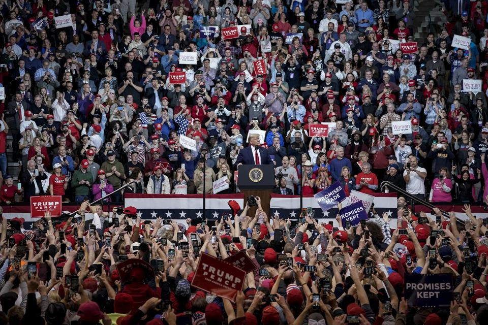 President Trump Holds Rally In New Hampshire Day Before State's Primary