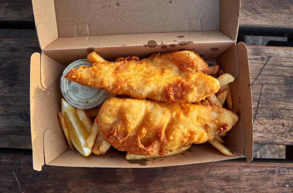 A takeaway serving of fish and chips, a classic Australian beachside meal.
