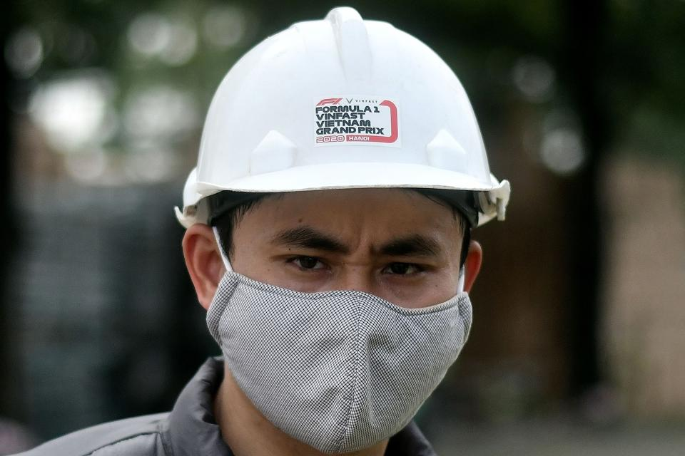 Even workers on the Vietnam Grand Prix are protecting themselves from the coronavirus (MANAN VATSYAYANA/AFP via Getty Images)
