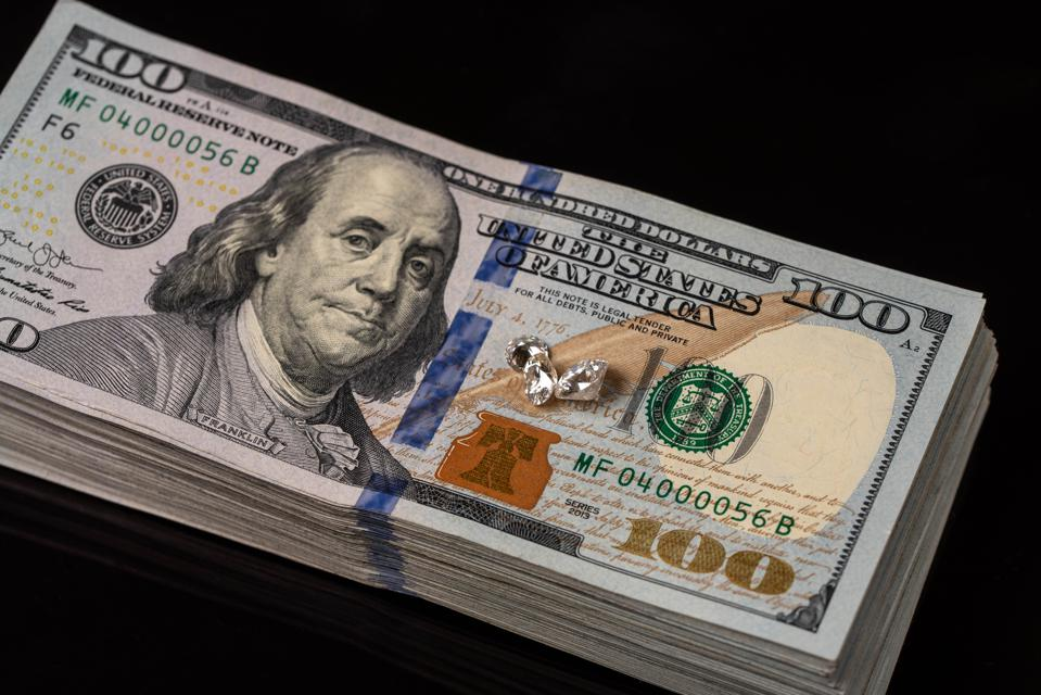 Stack of One Hundred Dollar Bills on Black Background