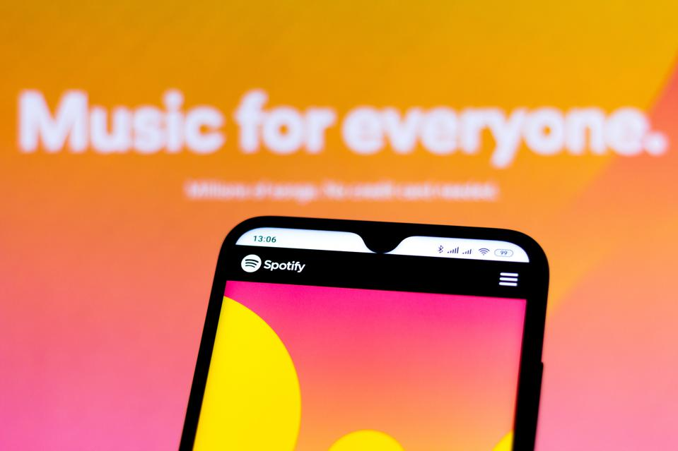 Photo illustration with the Spotify website.