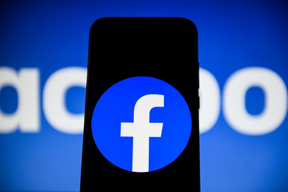 In this photo illustration a Facebook logo  seen displayed...