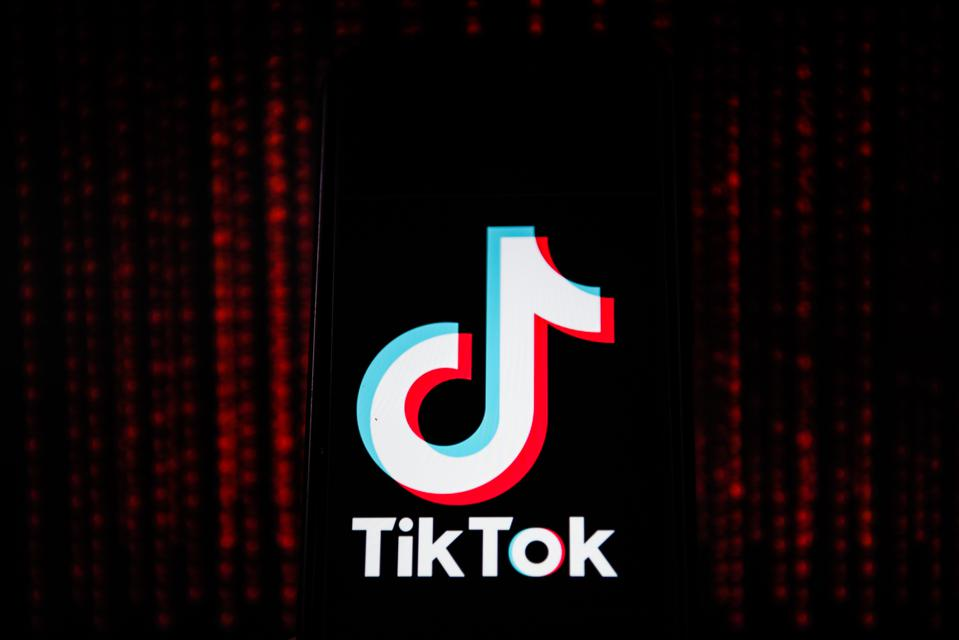 In this photo illustration a Tik Tok logo seen displayed on...