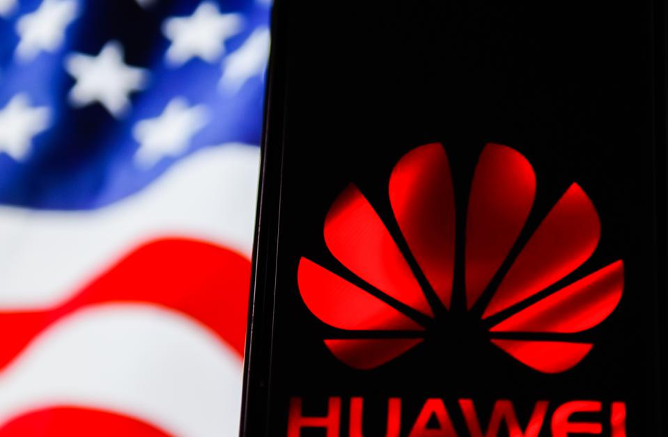 In this photo illustration a Huawei logo seen displayed on a...