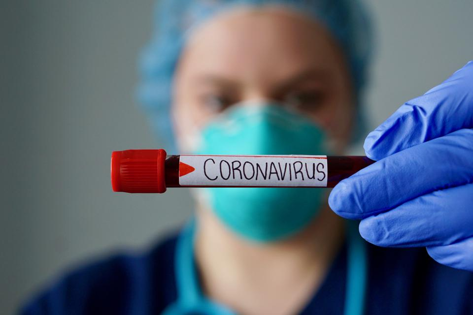Should you cancel your next vacation because of the coronavirus? Here's what other travelers are doing.