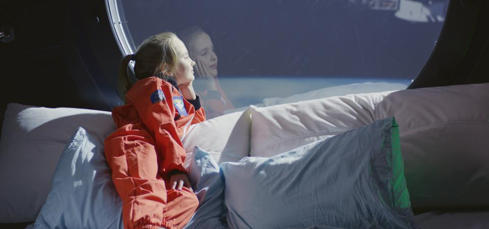 Girl looking out of spaceship window