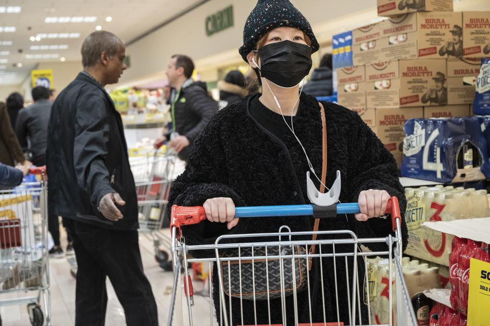 An Asian girl wearing a face mask seen shopping at a local...