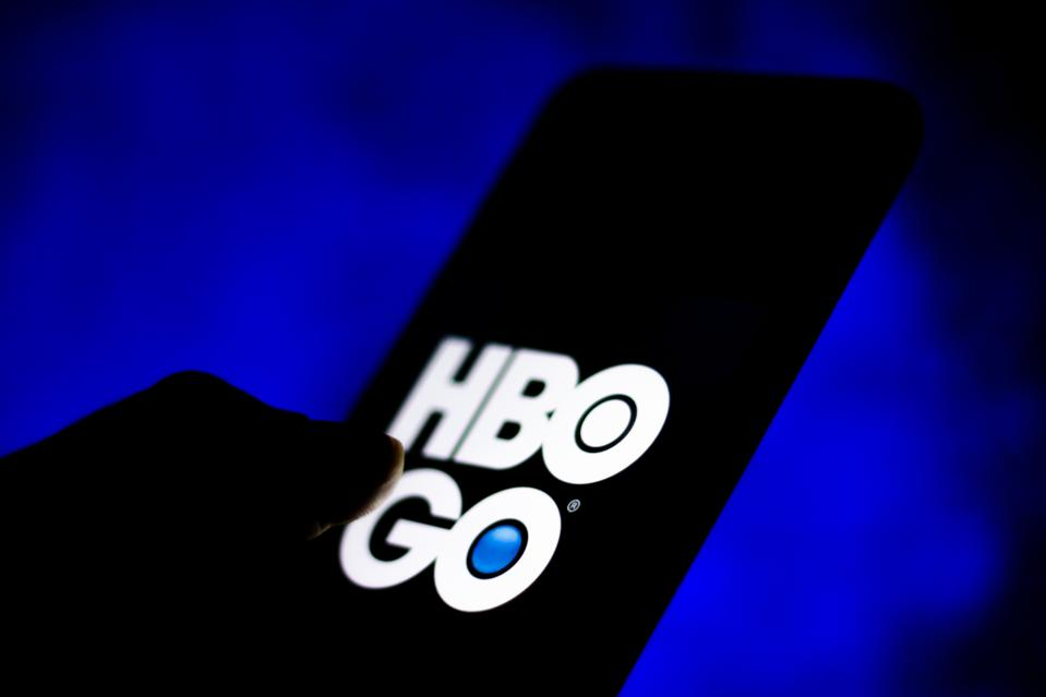 In this photo illustration a HBO Go logo seen displayed on a...