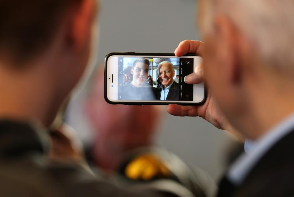 Democratic Presidential Candidate Joe Biden takes a Selfie Amid the Chaos