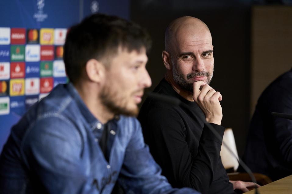 David Silva and Pep Guardiola coach of Manchester City...