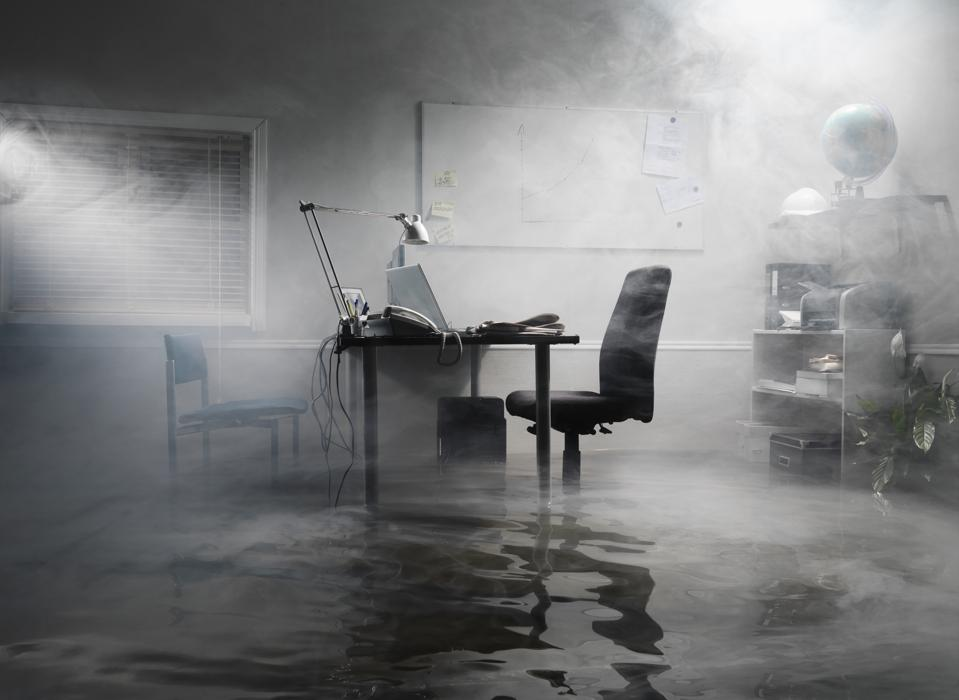 flooded office with smoke in the air