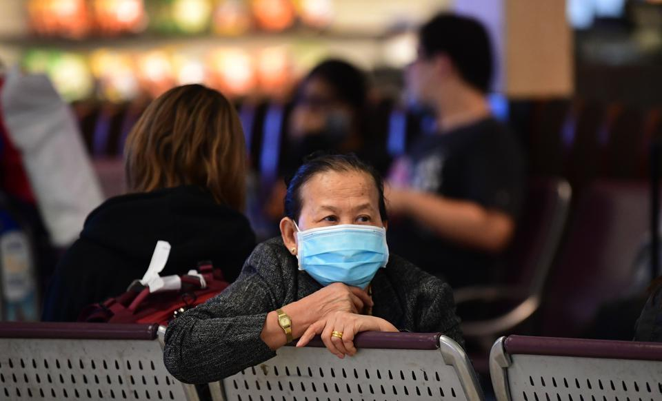 A woman wearing a face mask at Los Angeles International Airport on March 2.